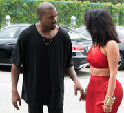 Kim Kardashian was a head turner at the Roc Nation pre-Grammy brunch in her sexy red outfit styled with chunky gold Lanvin cuffs.