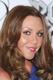 Michelle Heaton grabbed for the gloss at the 'Rock of Ages the Musical' after party. To get her look, try a product like Clinique Superbalm Moisturizing Gloss in shades Currant or Raspberry.