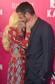 Lady Gaga embraced color for her 'Rock the Kasbah' premiere look, teaming neon-pink mani with a red and blue outfit.