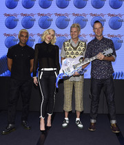 Gwen Stefani teamed her blouse with a cool pair of black capri pants with white trim by 7 For All Mankind.
