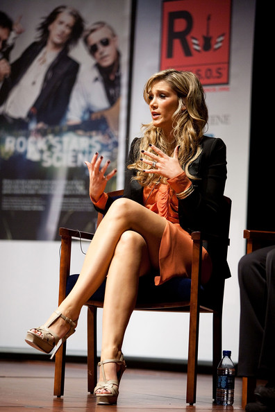 Delta Goodrem wore nude YSL Tribute sandals with a coral dress and a black blazer for the Rock Stars of Science event.