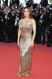 Eva Longoria brought major sparkle to the red carpet with this asymmetrical gold sequined gown by Cristina Ottaviano at the 2019 Cannes Film Festival screening of 'Rocketman.'