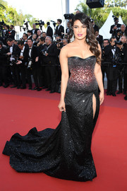 Priyanka Chopra got majorly glam in a fully embellished strapless gown by Roberto Cavalli Couture for the 2019 Cannes Film Festival screening of 'Rocketman.'