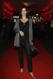 Ulrike Frank looked striking at the 'Rocky Horror Picture Show' Berlin premiere in a pair of black leather pants, a matching tank and a long charcoal cardigan.