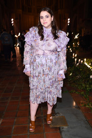 Beanie Feldstein opted for a pair of brown cutout booties to finish off her look.