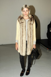 Emily Weiss was casual-glam in a fur coat layered over a sweater during the Rodarte fashion show.
