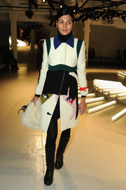 Giovanna Battaglia donned an on-trend face-print coat by Prada for the Rodarte fashion show.