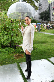 Cara Santana went for edgy styling with a pair of black thigh-high boots by Casadei.