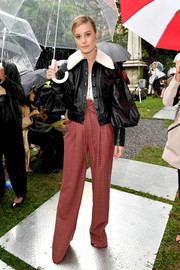 Brie Larson rocked a black Rodarte leather jacket with a shearling collar and puffed sleeves during the brand's Spring 2019 show.