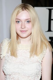With just a swipe of shimmery, white eyeshadow placed at the inner corners of her eyes, Dakota Fanning dramatically brightened up her baby blues at the Rodarte Spring 2012 fashion show.