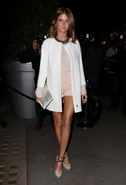 Millie Mackintosh chose a totally-modern look at the Rodial Beautiful Awards, when she sported this sleek white coat over a mini romper.