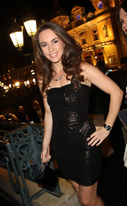 Liv Boeree perfectly matched her leather watch with this sparkly dress... a winning combo.