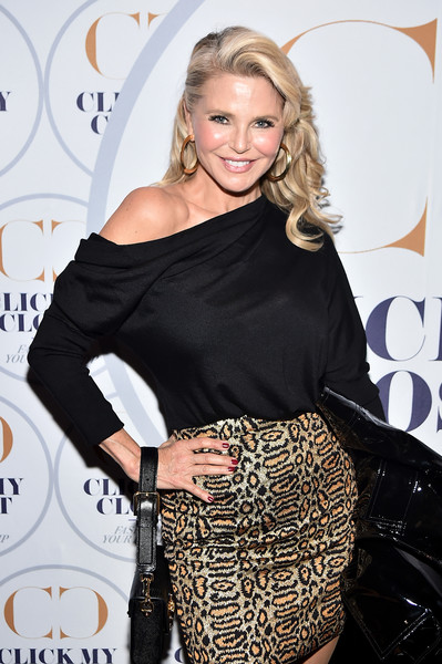 Christie Brinkley paired a black off-the-shoulder top with a leopard-print skirt for the launch of Click My Closet.