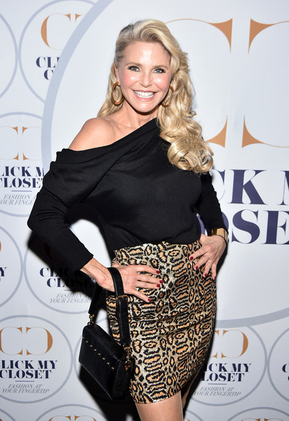 Christie Brinkley accessorized with a studded black purse at the launch of Click My Closet.