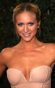 Brittany Snow attended the 'Rolling Stone' VIP party sporting a sleek bun with a classic center part.