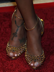 La La stepped out on the red carpet in seriously studded heels which showed off her rosary cross ankle tattoo.