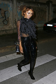 Kat Graham headed to the Rolling Stone party wearing a heavily ruffled black blouse.