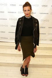 Katie Cassidy finished off her ensemble with black open-toe ankle boots.