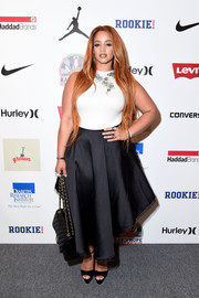 Dascha Polanco paraded her curves in a fitted white top during the Kids Rock! event.
