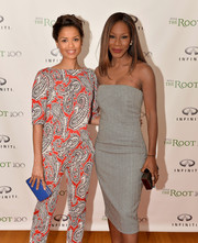 Gugu Mbatha-Raw embraced color, pairing a blue box clutch with a red, black, and white outfit at the Root 100 2014 List release reception.