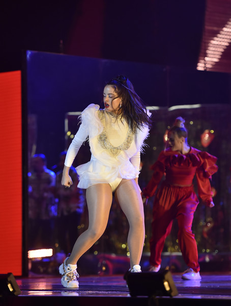 Rosalía Leather Sneakers [roaming show,performance,entertainment,performing arts,dancer,stage,event,public event,music artist,performance art,fashion,rosal\u00e3a,las vegas,nevada,mgm grand garden arena,latin grammy awards]