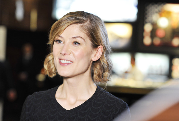 Rosamund Pike Short Curls [watches novelties,hair,face,hairstyle,lip,beauty,blond,eyebrow,chin,cheek,smile,iwc schaffhausen,rosamund pike,pilot,sihh 2016,booth,swiss,iwc,watch manufacturer,launch]