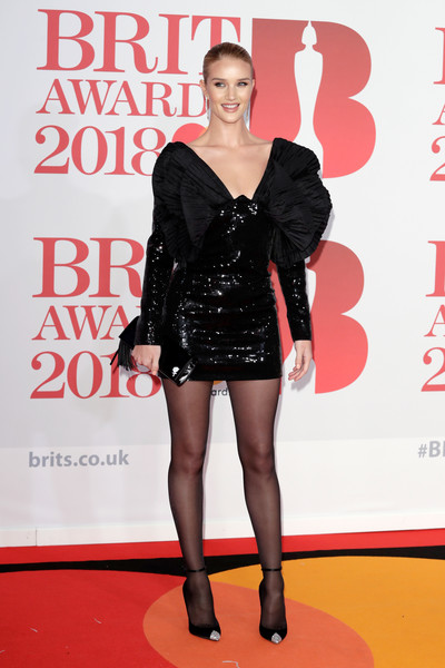 Rosie Huntington-Whiteley Evening Pumps [clothing,carpet,red carpet,fashion,little black dress,leg,premiere,flooring,dress,footwear,red carpet arrivals,rosie huntington-whiteley,brit awards,relation,the o2 arena,england,london]