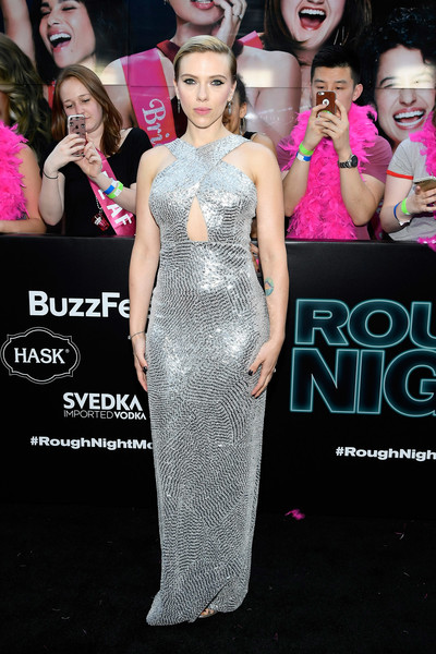Scarlett Johansson went the flashy route in a silver Michael Kors sequin gown with a peekaboo bodice and a halter neckline at the New York premiere of 'Rough Night.'