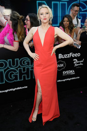 Kate McKinnon opted for a modern look with this asymmetrical red gown by Michelle Mason when she attended the New York premiere of 'Rough Night.'