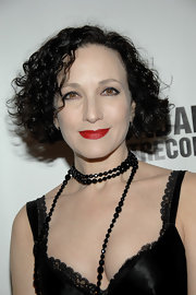 Bebe Neuwirth added a dash of color to her mysterious look with a splash of red lipstick.