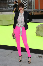 Jasmine paired a classic blazer over a pair of bright pants and a newsprint blouse.