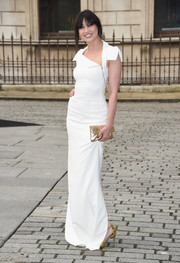 Daisy Lowe's gold clutch made a chic contrast to her white gown.