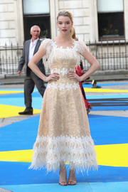 Anya Taylor-Joy looked downright darling in a feathered and flower-embroidered dress by Huishan Zhang at the Royal Academy of Arts Summer Exhibition preview.