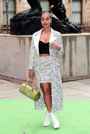 Jorja Smith hit the Royal Academy of Arts Summer Exhibition wearing a 16Arlington dalmatian-print coat, a matching mini skirt, and a black corset top.