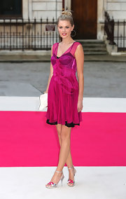 Wearing a hot pink color like Donna Air promises you'll be remembered.