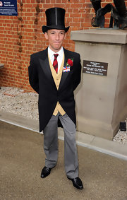 Frankie Dettori wore a top hat with his formal suit for some old-world elegance.