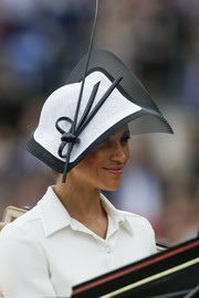Meghan Markle donned a sculptural black-and-white hat by Philip Treacy for Royal Ascot 2018.