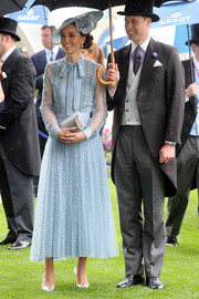 Kate Middleton looked perfectly refined in a pastel-blue pussybow blouse by Elie Saab at Royal Ascot 2019.