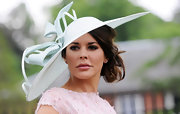 Danielle Buz wore a soft sea foam-hued wide-brimmed hat that featured a delicate bow detail.