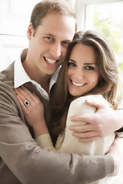 Kate was lovely in a cream silk blouse in her engagement photos with Prince William.