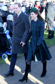 Kate Middleton attended Christmas Day service wearing a blue and green tartan coat by Alexander McQueen.