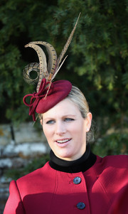 Zara Phillips topped off her ensemble with a feathered fuchsia hat during Christmas Day service.