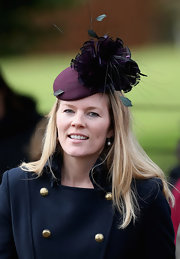 Autumn Phillips wore an exquisite purple hat with a large oversized flower decoration at Christmas Day service at Sandringham.