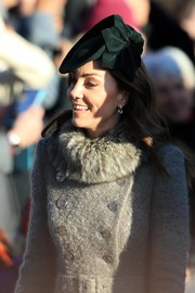 Kate Middleton accessorized with a pair of green amethyst and diamond earrings by Kiki McDonough for Christmas day church service.