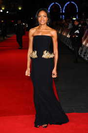 Naomie Harris looked ultra elegant in a stapless black Alexander McQueen gown with embellished peplum detail during the 'Mandela' screening in London.