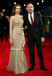Daniela Lavender wore a shining gold evening dress with high neck to the Royal Film premiere of 'Hugo.'
