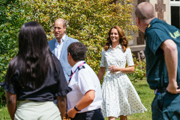 Kate Middleton looked cute and youthful in a printed shirtdress by Suzannah while attending a Royal Foundation event.
