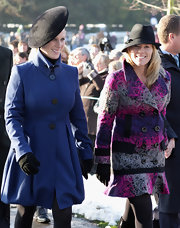 Autumn Phillips wore a gorgeous multicolored print wool coat to attend Christmas Day service at Sandringham.