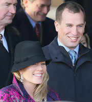 Autumn Phillips looked fashionable while wearing a black fedora hat to attend Christmas Day service at Sandringham.