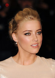 Amber Heard wore her hair in a chic bobby-pinned updo at 'The Rum Diary' premiere.